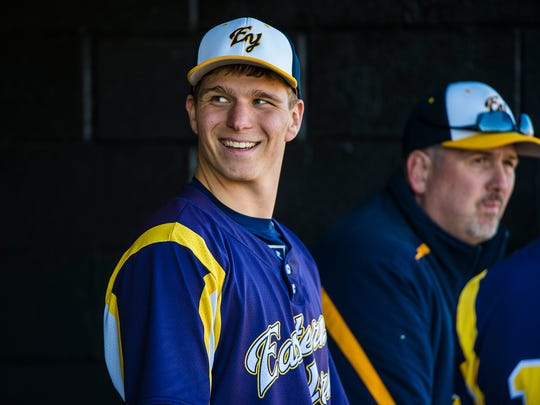 Eastern York's Brandon Knarr talks with a teammate in the dugout during the game against Hanover at Hanover High School on April 5, 2016.