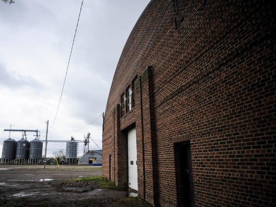 The West Bank Landing development project will include renovating the historic Barrel Building, foreground, and removing grain bins to build other projects, including an upscale hotel near West Bank Park.