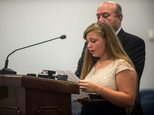Ashley Smith, 15, the daughter of Melissa Wright, speaks