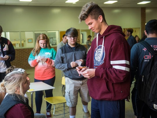 New Oxford High School students vote during a mock election on Tuesday.