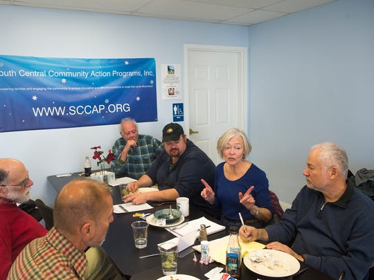 Members of the local chapter of the Prison Society meet at the SCAAP cafe in Gettysburg on Dec. 14, 2016.