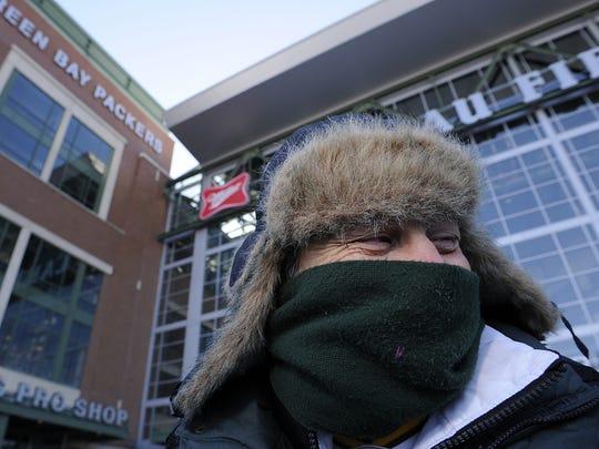 Jeffrey Gideon of Irvington, N.Y., braves the cold  while walking around Lambeau Field.