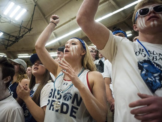 The Great Falls student section cheers during the Crosstown
