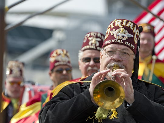Members of the band for Syrian Shriners Temple in Cincinnati play in a parade. The local temple oversees the Shriners Hospital for Children in Cincinnati, which on March 13 announced that it will move its treatment facility to Dayton and sell the 30-bed Burnet Avenue hospital.