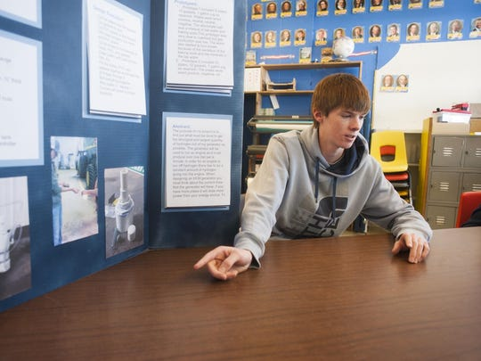 """Hayden Heilig, senior, discusses his science fair project, which is taking him to the National INTEL Science Fair in Los Angeles, Calif. Heilig built a hydrogen generator to improve the fuel efficiency on his Chevrolet truck. """"I don't like sitting still,"""" he said."""