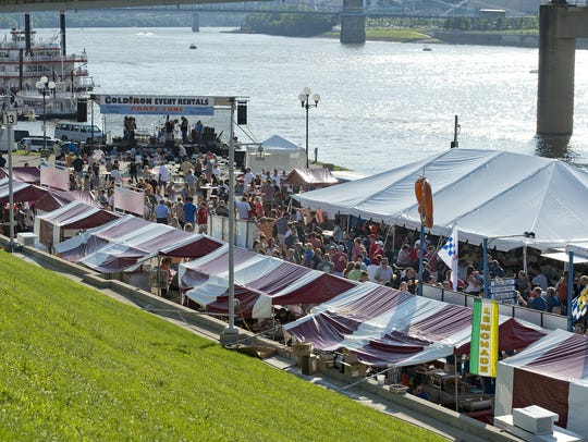 The Bacon, Bourbon and Brew Festival takes place along Riverboat Row in Newport, featuring bacon and other pork products, Kentucky bourbon and beers from local breweries. Food and drink stalls lead to the stage along Riverboat Row.