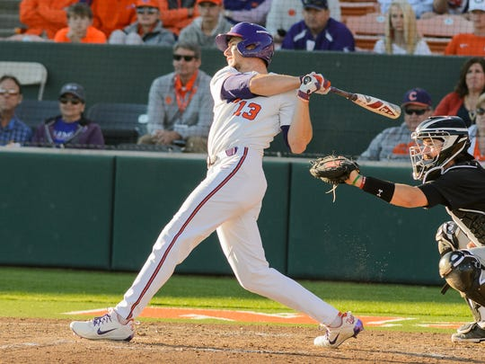 Clemson's Drew Wharton (13) gets the game winning hit in the bottom of the 9th inning against South Carolina on Sunday in Clemson's Doug Kingsmore Stadium.'s Justin Hawkins (right) slides into 2nd base after hitting the ball into the left field corner for a double against South Carolina on Sunday in Clemson's Doug Kingsmore Stadium.