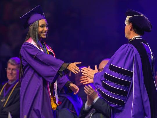 Emily Bencosme graduates from Northwestern State University