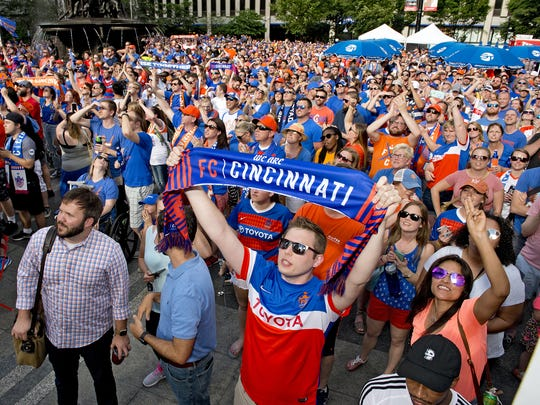 Thousands of FC Cincinnati Soccer fans gathered on Fountain Square on Tuesday, May 29, 2018 to watch a live broadcast from Rhinegeist Brewery announcing that the team was accepted into Major League Soccer. The crowd responds to the big screen on Fountain Square as the announcements are made at Rhinegeist Brewery.