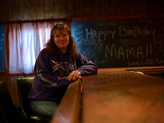Kim Vanden Busch, shown inside her idled tavern property, locked out tenant Amy Stevenson in a business dispute, and now wants the liquor license so she can open her own bar.