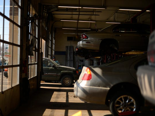 A vehicle pulls into the garage at Auto Aces, W. Mason