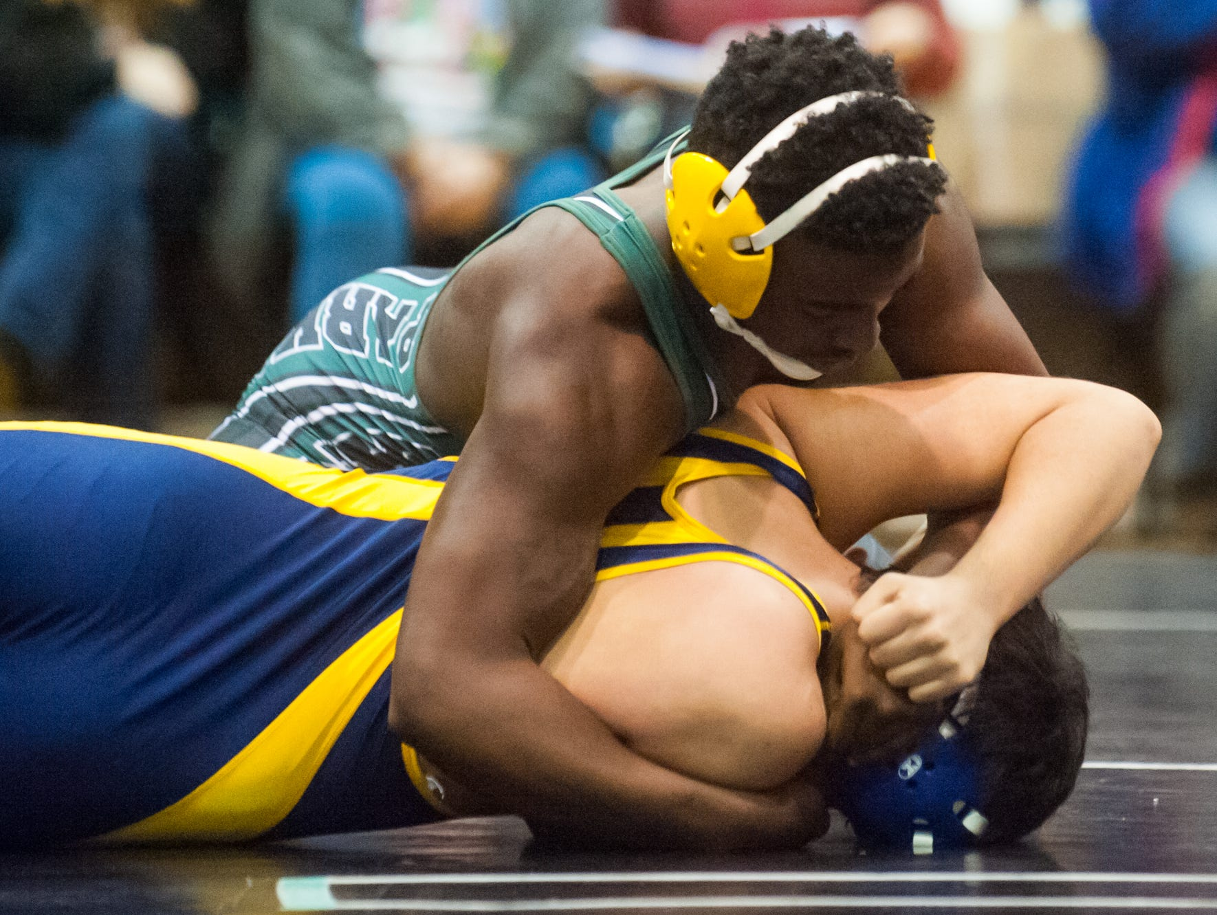 Parkside's Brent Hayman (200lb) attempts to wrap up his opponent during the Bob Rowe Memorial Classic on Friday evening at James M. Bennett High in Salisbury.