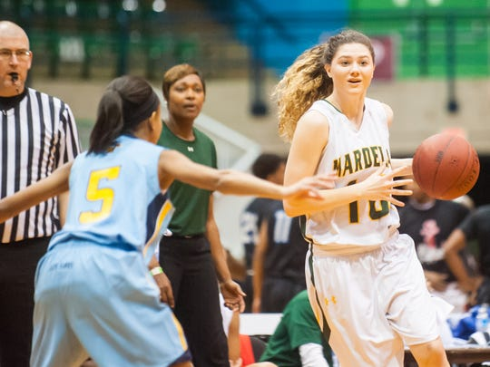Mardela guard Taylor Ross (10) works up court against River Hill in the Governor's Challenge at the Wicomico County Youth and Civic Center.