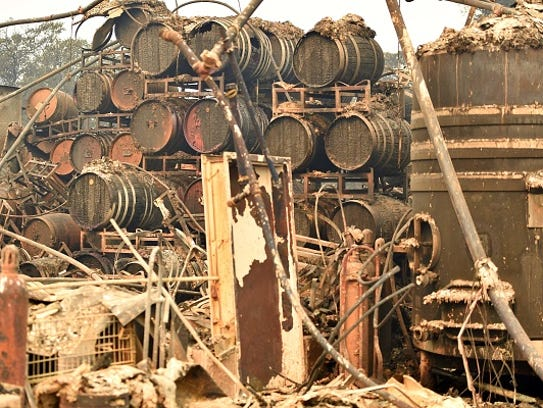 Burned wine barrels are seen at a destroyed Paradise