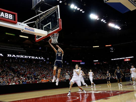 Whitnall's Tyler Herro (14) goes up for a basket past