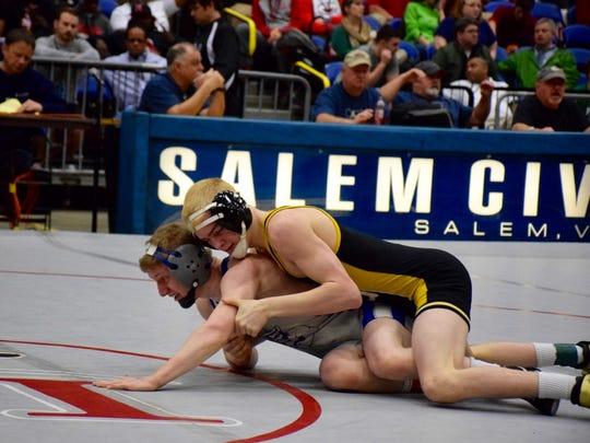 Buffalo Gap's Cullen Bendel, top, tries to control