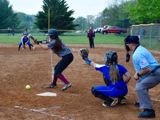 Stuarts Draft's Sydney Montoya lays down a sacrifice bunt in the seventh inning of the Cougars' game against Fort Defiance on Wednesday, April 27, 2016, in Stuarts Draft.