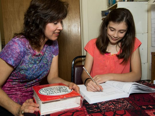 Kathleen Campbell and her daughter Grace work on lessons