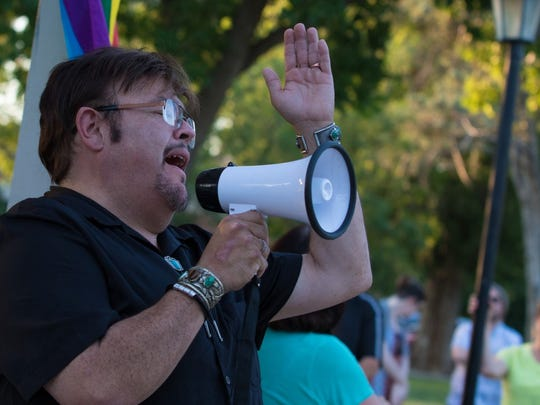 Orlando Antonio Jimenez sings at the prayer vigil for the victims of the Orlando shooting held Sunday, June 12, 2016, at Pioneer Women's Park in Las Cruces.