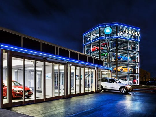 "Carvana buyers use a special  coin to retrieve their vehicle from the company's ""vending  machine"" near Nashville."