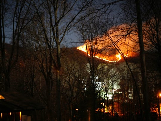Flames from a brush fire in Harriman State Park could be seen from residences near Tranquility Road in Wesley Hills, Nov. 13, 2016.