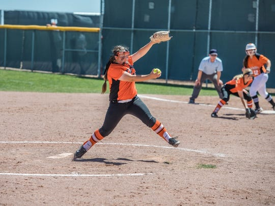 Aztec's Paige Adair pitches against Artesia on Friday at Cleveland High School in Rio Rancho.