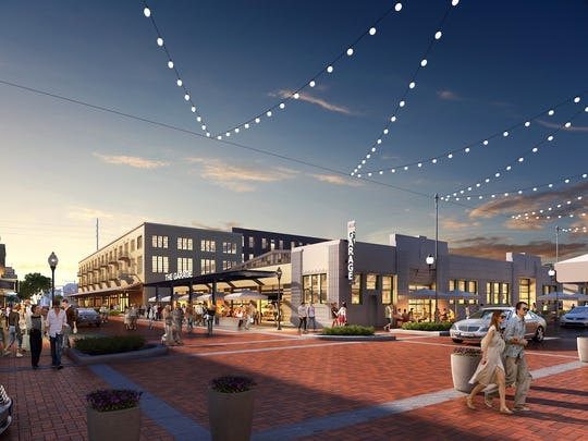A rendering shows how the a food hall might look at the Coca-Cola bottling plant's garages on Mass Ave. in Indianapolis.