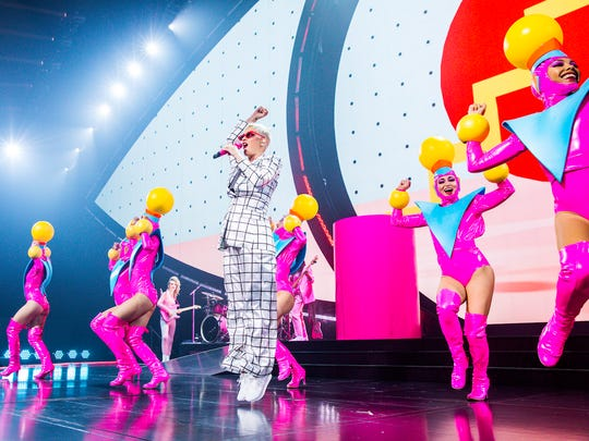"Katy Perry is accompanied by 10 dancers on her ""Witness"" tour. One of show co-director Ashley Evans' favorite performances is a quirky, '80s-influenced run-through of early Perry hits like ""Hot N Cold."""