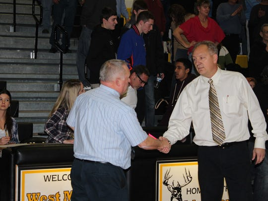 West Milford veteran boys' basketball coach John Finke, right and Wayne Valley coach Joe Leicht, are longtime friends both on and off the court. Both coaches and their respective teams came together last week for a Holiday Toy Drive for local children and families in need.