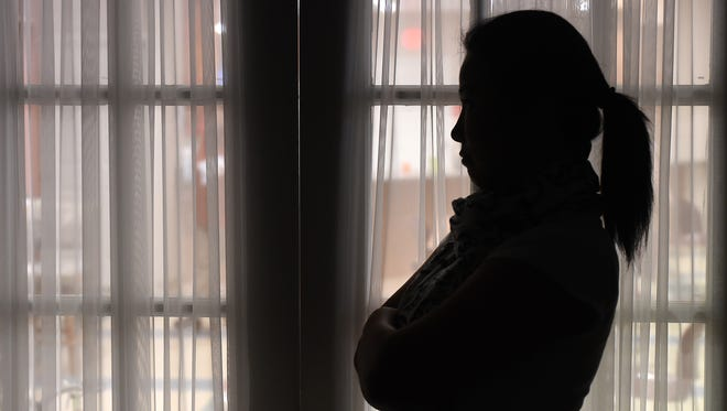 A client at Serenity talks Tuesday about the importance of domestic violence shelters like the one in Mountain Home. Shelters like Serenity often are the last hope for victims of domestic abuse. October is Domestic Violence Awareness Month.