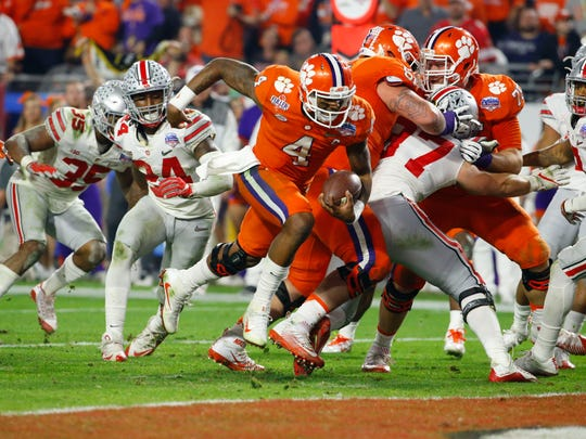 Clemson Tigers quarterback Deshaun Watson (4) runs the ball for a touchdown against Ohio State during the third quarter of the College Football Playoff Semifinal game in the PlayStation Fiesta Bowl on Dec. 31, 2016 at University of Phoenix Stadium in Glendale, Arizona.