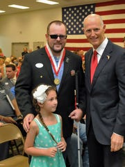 The Governor's Veterans Service Award ceremony at the Melbourne National Guard Armory, with hundreds of veterans from several wars, including WW II, Korea, Vietnam, Iraq, and Afghanistan receiving the medal from Governor Rick Scott.
