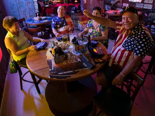 From left, Cape Coral residents Jan Strader, Duane Tihen, Bonnie Polzein and Rich Primm play trivia at Bubba's Roadhouse & Saloon Thursday afternoon, June 14. The four team members are regulars at the  establishment and compete nationally with other players.