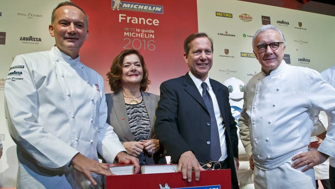 From left, French Chef Christian Le Squer, Executive Vice President Brands and External Relations of Michelin Claire Dorland-Clauzel, Worldwide Michelin Guide Director Michael Ellis and French Chef Alain Ducasse pose for the media after the Michelin Guide 2016 award ceremony in Paris, Monday, Feb. 1, 2016. French Chef Alain Ducasse with his restaurant in Paris' Plaza Athenee and French Chef Christian Le Squer with his restaurant Le Cinq in Paris were newly awarded with the prestigious 3 stars this year.