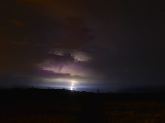 Lightning strike on Monday night near Sand Spring, Mont. where the Lodgepole Complex fires have burned more than 250,000 acres and destroying 16 residences and secondary residences as of Monday night.