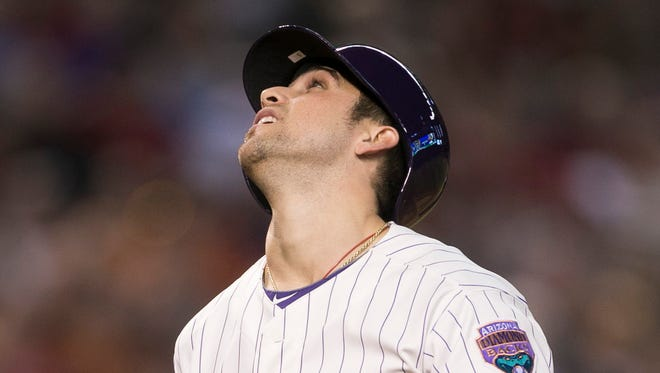 Diamondbacks' Ender Inciarte looks up at a pop-foul against the Rockies at Chase Field in Phoenix, AZ on Saturday, August 30, 2014.