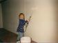 Gabrielle painting interior walls.