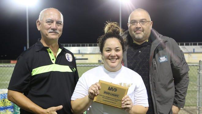 The Venue Slay's goalkeeper Tamera Shimizu with the championship match MVP plaque. From left: Gian Tenorio, GFA executive committee member; Shimizu; and Jojo Camacho, Ambros marketing manager.