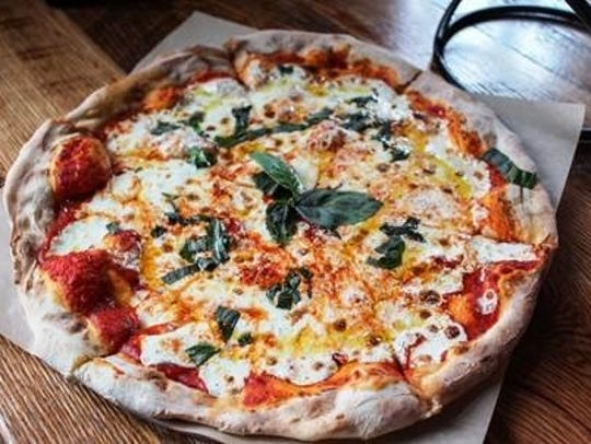 A wood-fired pizza from City Tap