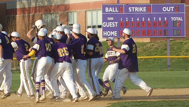 Cherry Hill West celebrates its 3-2 victory over Eastern in nine innings Monday.