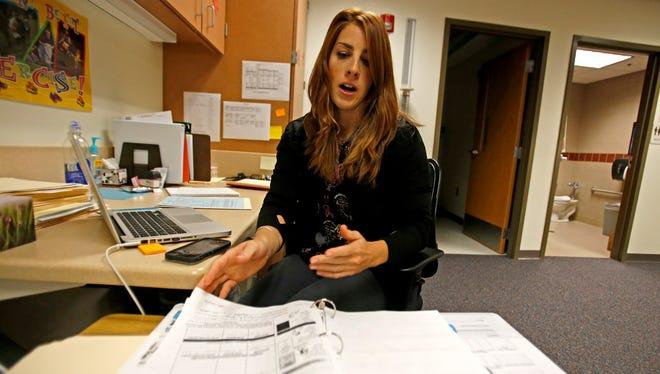 School nurse Carly Mead goes through student records on Friday at Animas Elementary School in Farmington.