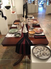 Table settings curated by Robin Warden, each piece done by different artist, are part of the TRAC auction event July 9.