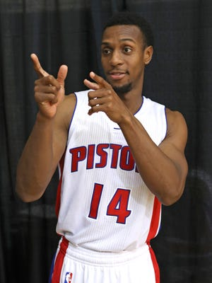 Detroit Pistons guard Ish Smith points during media day Monday, Sept. 26, 2016, in Auburn Hills.
