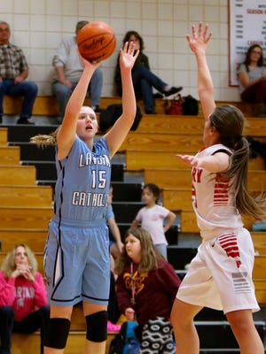 Lansing Catholic junior Becka Poljan drops in two against Perry Tuesday, Nov. 29, 2016, at Perry.