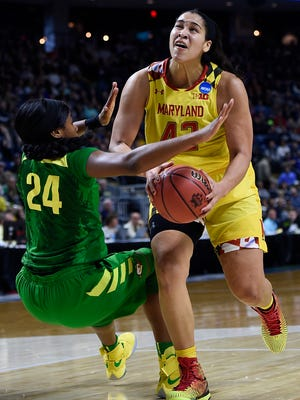Maryland's Brionna Jones, right, drives past Oregon's Ruthy Hebard during the second half of a regional semifinal game in the NCAA women's college basketball tournament, Saturday, March 25, 2017, in Bridgeport, Conn.