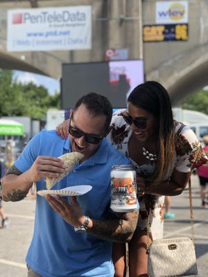 Patrons enjoy eats from Take-A-Taco at a previous Musikfest.