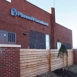 The new Planned Parenthood location in Louisville halted abortions Friday, Jan. 29, 2016, after objections Kentucky raised about its license application. The organization released information showing officials in former Gov. Steve Besear's administration authorized it to start providing abortions.
