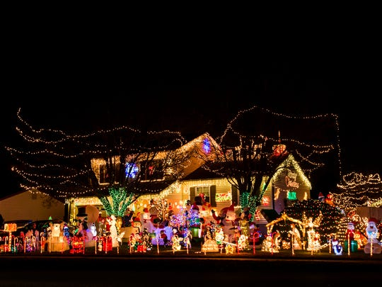 The Newark home of Barbara Hurley and Harry Christensen is completely decorated for Christmas with dozens of inflatable creatures and lights on Wednesday night.