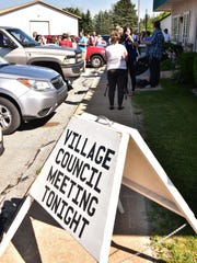 Attendees to a scheduled village council meeting gather outside the village offices in Kalkaska, Michigan after the meeting was canceled to due lack of a quorum on Wednesday, July 19, 2017. (Special to the Detroit News/John L. Russell)