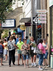 Visitors to downtown Traverse City walk down Front Street.